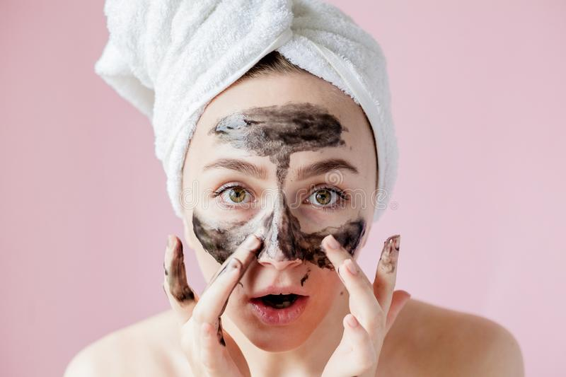 Beauty Cosmetic Peeling. Closeup Beautiful Young Female With Black Peel Off Mask On Skin. Closeup Of Attractive Woman With. Cosmetic Skin Care Peeling Product royalty free stock image