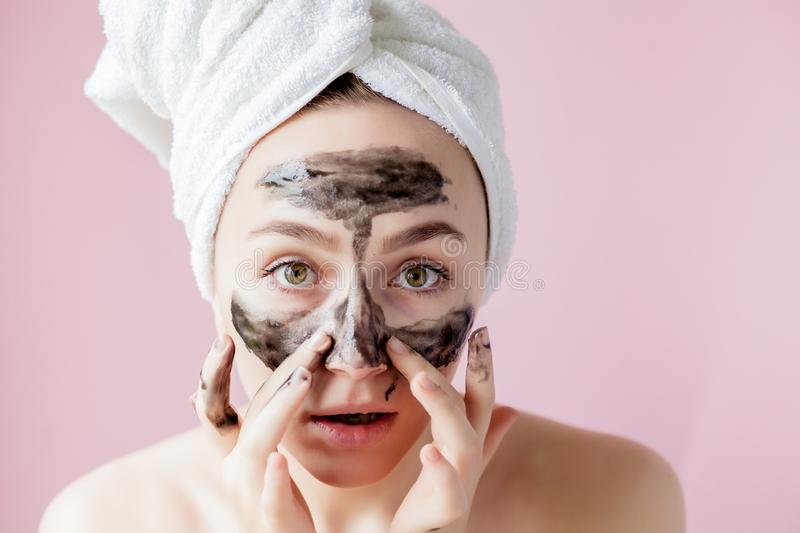 Beauty Cosmetic Peeling. Closeup Beautiful Young Female With Black Peel Off Mask On Skin. Closeup Of Attractive Woman With. Cosmetic Skin Care Peeling Product royalty free stock images