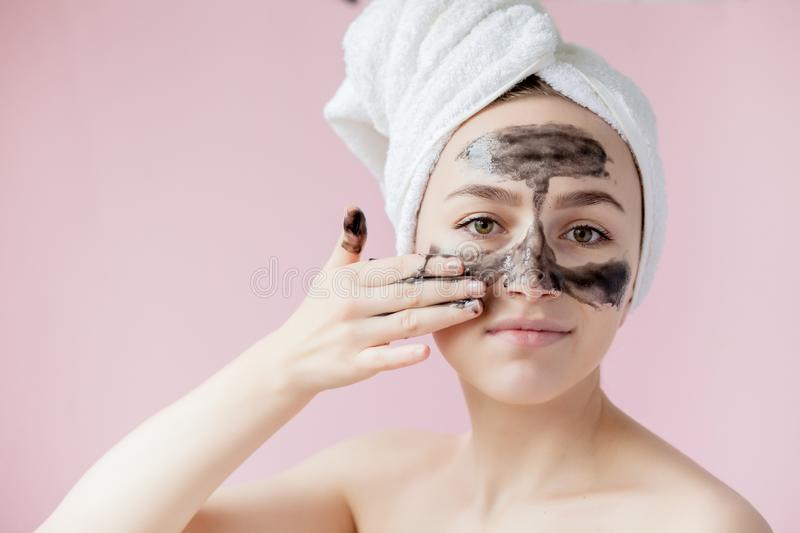 Beauty Cosmetic Peeling. Closeup Beautiful Young Female With Black Peel Off Mask On Skin. Closeup Of Attractive Woman With royalty free stock images
