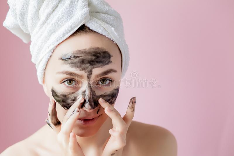 Beauty Cosmetic Peeling. Closeup Beautiful Young Female With Black Peel Off Mask On Skin. Closeup Of Attractive Woman With royalty free stock photography