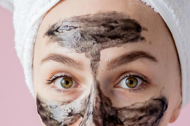 Beauty Cosmetic Peeling. Closeup Beautiful Young Female With Black Peel Off Mask On Skin. Closeup Of Attractive Woman With royalty free stock photos
