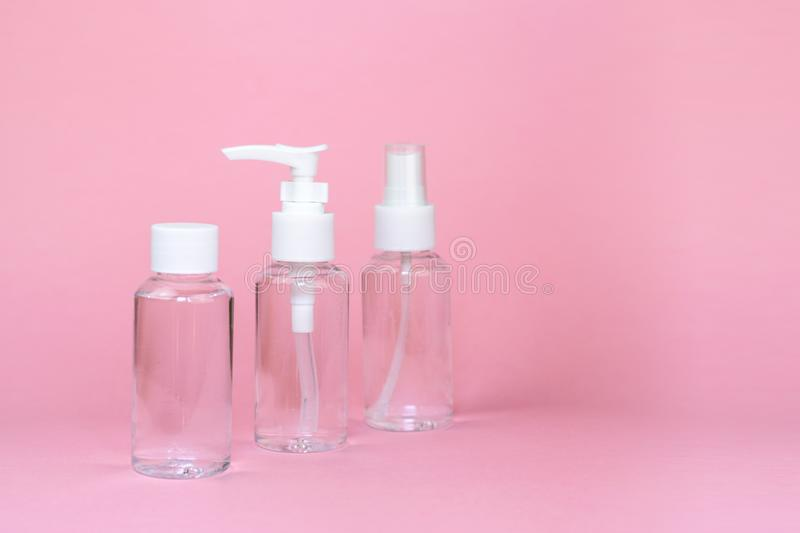 Beauty cosmetics glassbottle; branding mock up; front view on pastel pink background. stock images