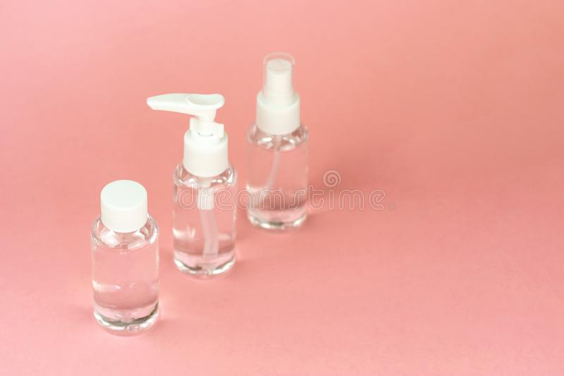 Beauty cosmetics glassbottle; branding mock up; front view on pastel pink background. stock photography