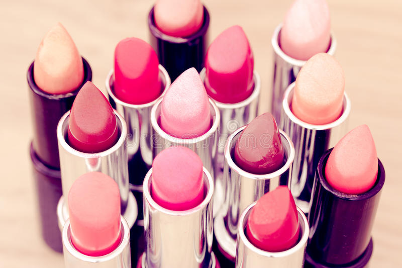 Beauty & cosmetics:lipsticks and lipgloss royalty free stock photo