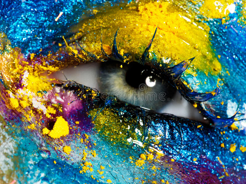 Beauty, cosmetics and makeup. Bright creative make-up. Beauty, cosmetics and makeup. Magic eyes look with bright creative make-up. Macro shot of beautiful woman` royalty free stock image