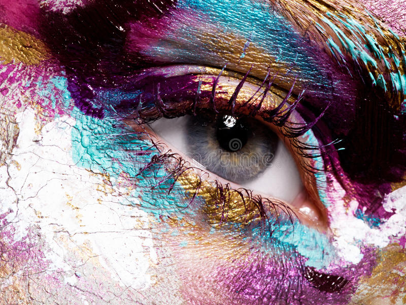 Beauty, cosmetics and makeup. Bright creative make-up. Beauty, cosmetics and makeup. Magic eyes look with bright creative make-up. Macro shot of beautiful woman` royalty free stock photo