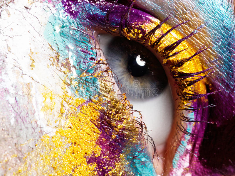 Beauty, cosmetics and makeup. Bright creative make-up. Beauty, cosmetics and makeup. Magic eyes look with bright creative make-up. Macro shot of beautiful woman` royalty free stock images