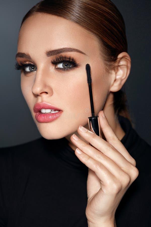 Beauty Cosmetics. Woman Putting Black Mascara On Long Eyelashes. Beauty Cosmetics. Closeup Of Beautiful Woman Putting Black Mascara On Long Thick Eyelashes With stock images