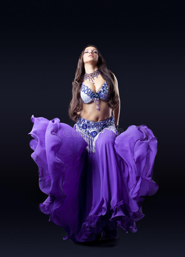Download Beauty Dancer Posing In Dark With Fly Purple Veil Stock Image - Image: 21386411