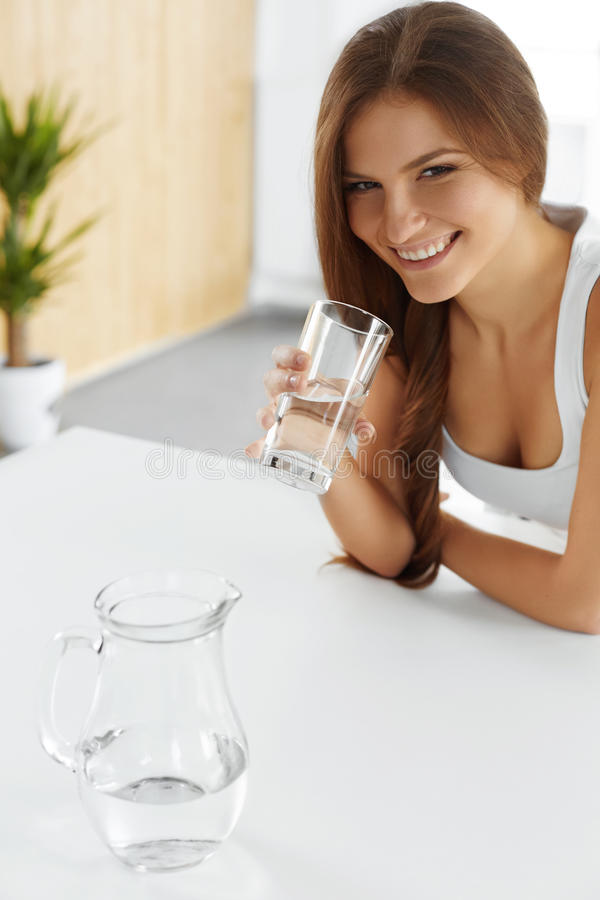 Beauty, Diet Concept. Happy Smiling Woman Drinking Water. Health. Drinking Water. Smiling Beautiful Woman Drinking Fresh Crystal Clear Water From A Glass royalty free stock images