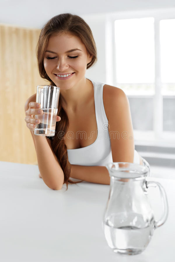 Beauty, Diet Concept. Happy Smiling Woman Drinking Water. Health. Beauty, Diet Concept. Happy Smiling Woman Drinking Fresh Crystal Clear Water From A Glass royalty free stock images