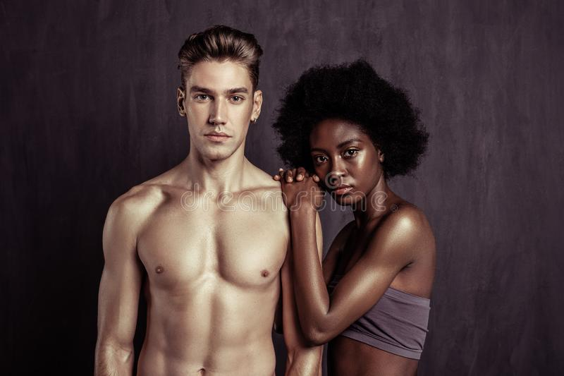 Serious attractive couple posing together for a photo stock photography