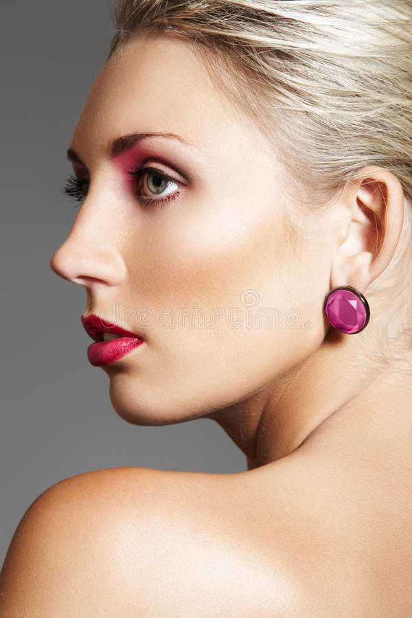 Beauty with evening make-up, bright lips & jewelry stock images
