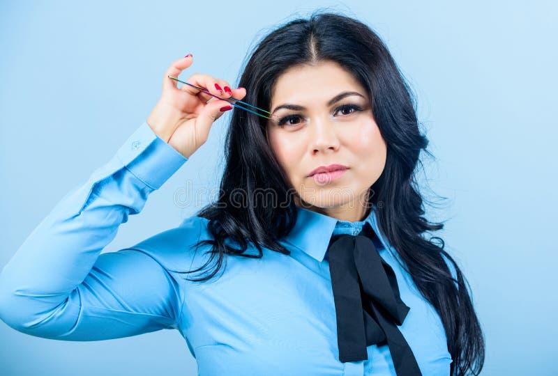 Beauty expert. Cosmetic tweezer tool. Beauty shop concept. Makeup false lashes volume. Eyelash extension tweezer. Girl stock photo