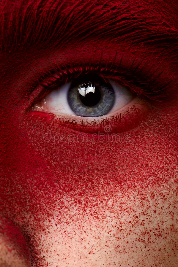 Beauty eye with red paint makeup. Beauty eye with red dry paint makeup royalty free stock image