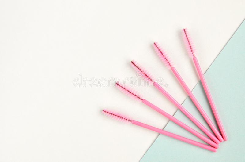 Beauty of eyelashes and eyebrows: eyelash extension tools and decor on white background with copy space. top view. Flatley. Beauty of eyelashes and eyebrows stock images