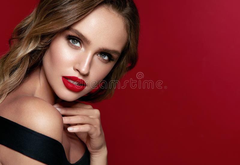 Beauty Face. Beautiful Woman With Makeup And Red Lips. royalty free stock image