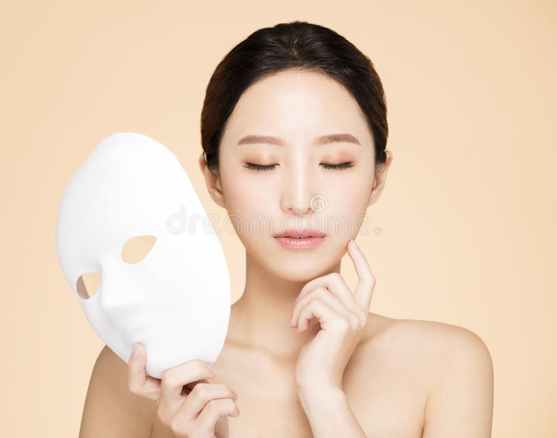 Beauty face with facial mask concept stock image