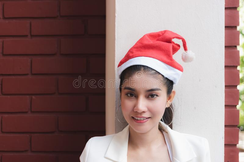 Beauty face of smiling Asian woman wearing santa claus hats. Christmas holiday concept. Beauty face of smiling Asian woman wearing santa claus hats. Christmas royalty free stock images