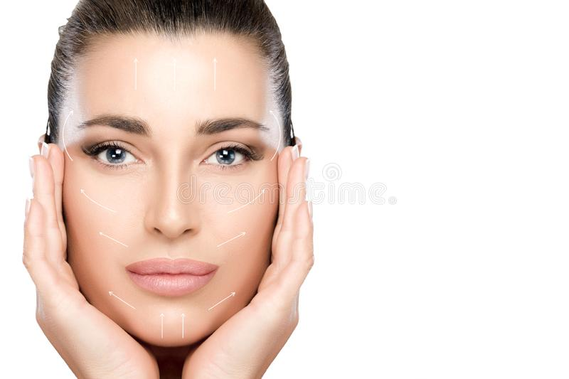 Beauty Face Spa Woman. Surgery and Anti Aging Concept. Anti aging treatment and plastic surgery concept. Beautiful young woman with hands on cheeks looking to royalty free stock photography