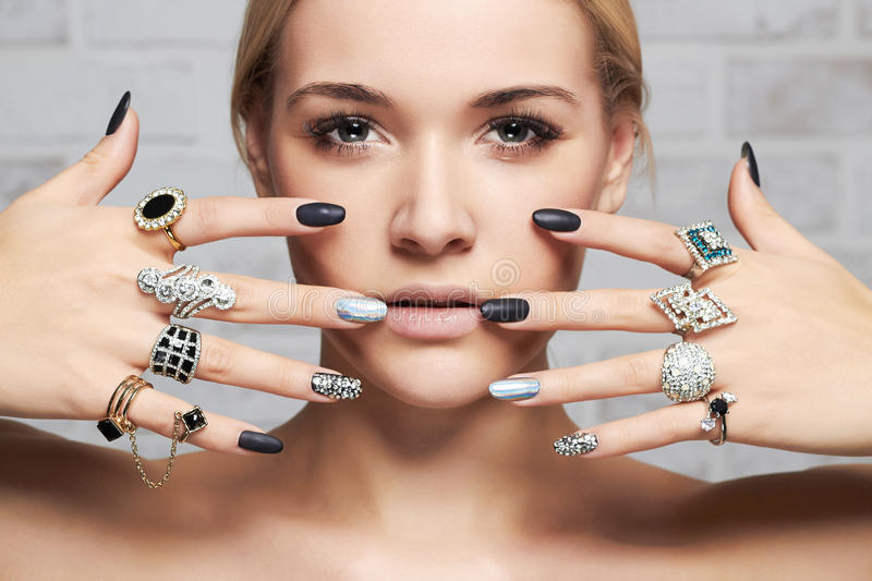 Beauty face.woman`s hands with jewelry rings stock images