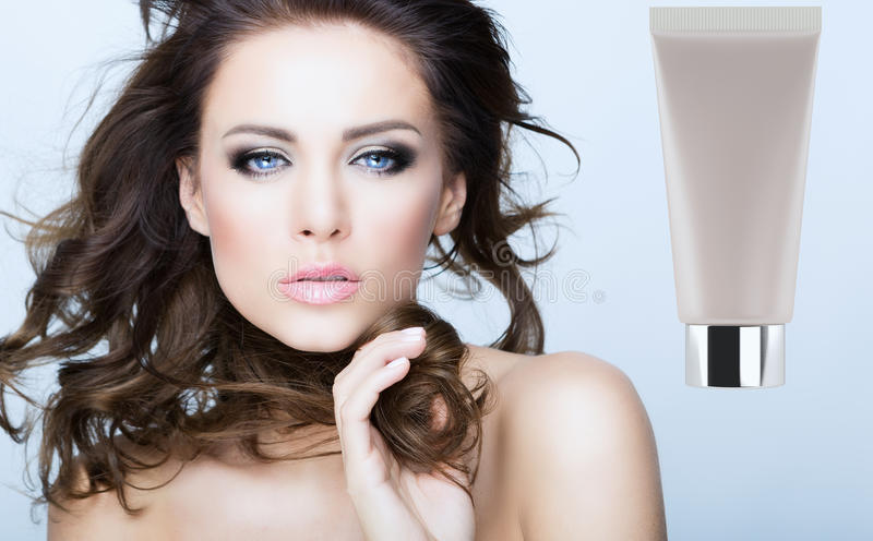 Beauty face. Woman with a beauty face and tube royalty free stock images