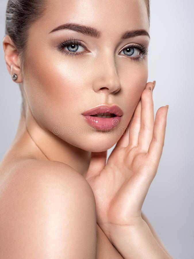 Beauty face of the young beautiful woman stock photos