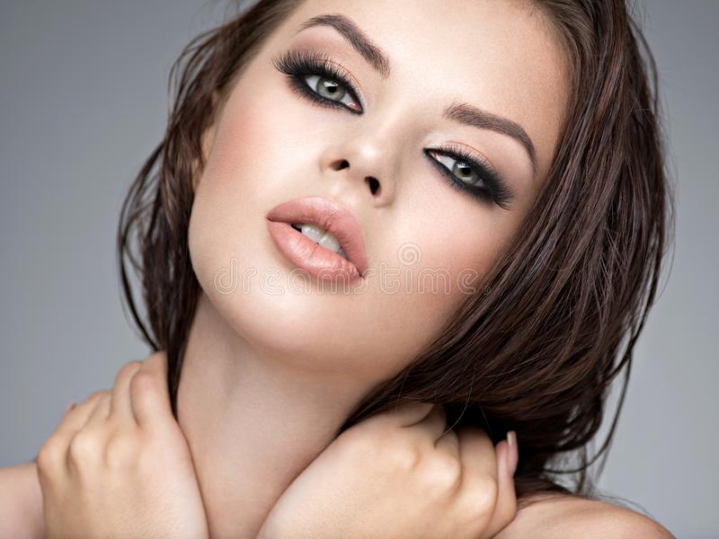 Beauty face of the young beautiful woman royalty free stock photos