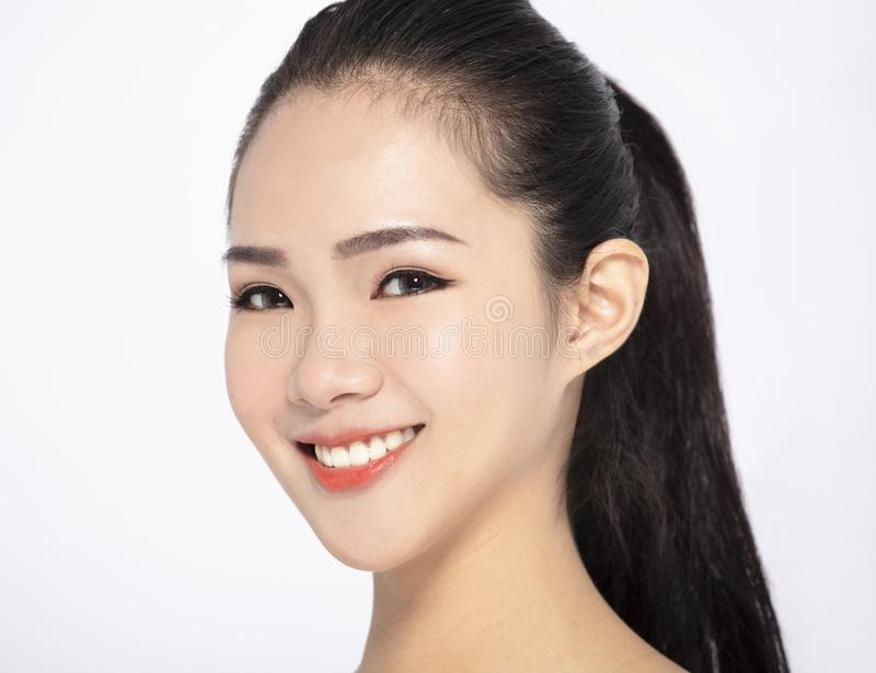 Beauty face of the young beautiful woman royalty free stock photography