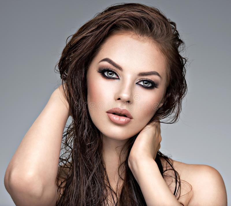 Beauty face of the young beautiful woman stock image