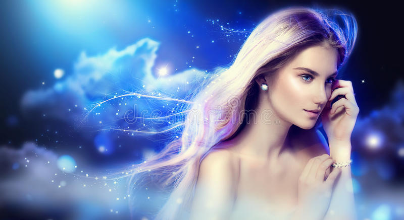 Beauty fantasy girl over night sky. Beauty fantasy girl with long blowing hair over night sky