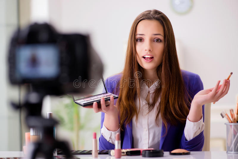 The beauty fashion blogger recording video. Beauty fashion blogger recording video royalty free stock image