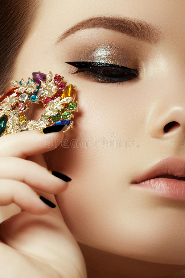 Beauty and fashion concept. Beautiful woman with jewelry royalty free stock photography