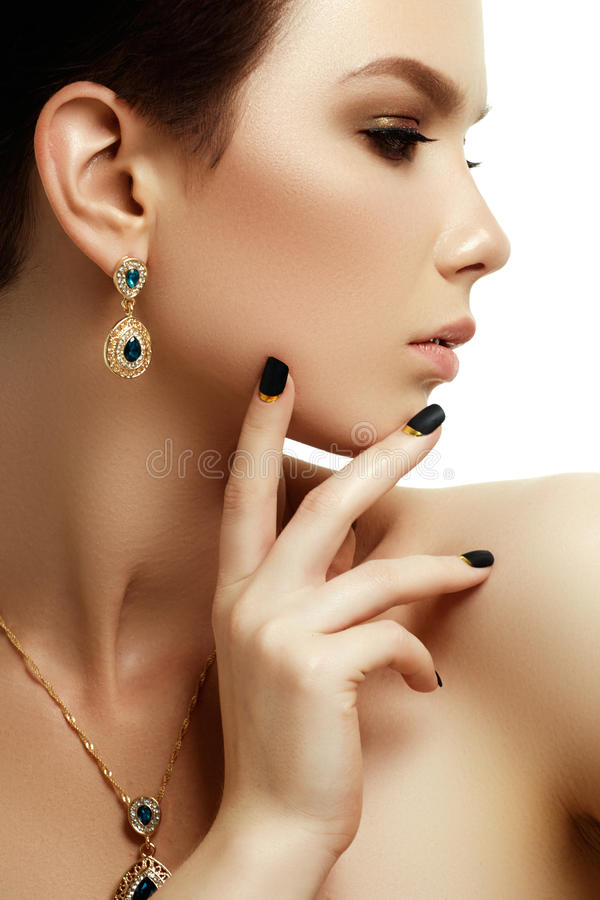 Beauty and fashion concept. Beautiful woman with jewelry royalty free stock image