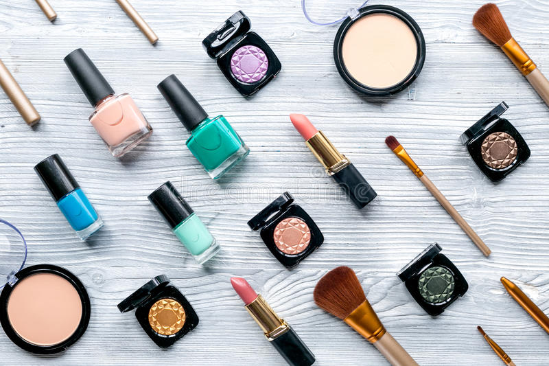 Beauty and fashion concept with decorative cosmetics on table background top view. Beauty and fashion concept with decorative cosmetics on gray wooden table royalty free stock photo