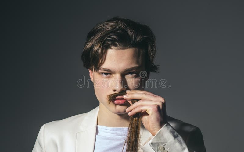 Beauty and fashion. Hair style and skincare. Man with trendy look. Fashion man with mystery look. Modern male stock images