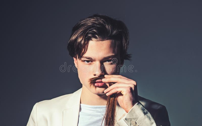 Beauty and fashion. Hair style and skincare. Man with trendy look. Fashion man with mystery look. Modern male stock image
