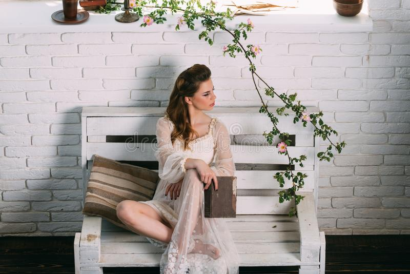 Beauty and fashion look in vintage style. Fashion woman model read book. Poetry book at romantic writer. Pretty girl in royalty free stock images