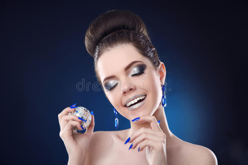 Beauty Fashion makeup and manicure nails. Smiling girl with cute stock images