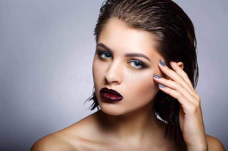 Beauty fashion model girl with bright make up. stock photos