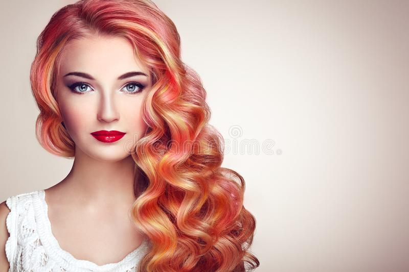 Beauty fashion model girl with colorful dyed hair. Girl with perfect Makeup and Hairstyle. Model with perfect Healthy Dyed Hair. Rainbow Hairstyles stock image