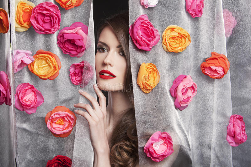 Beauty fashion model girl portrait with flowers. Beautiful luxury makeup and hair stock photo