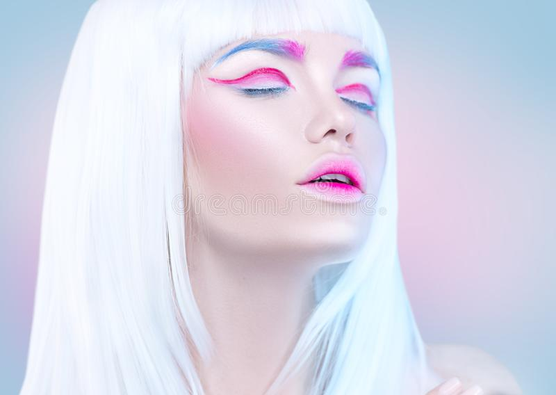 Beauty fashion model girl portrait with white hair, pink eyeliner, gradient lips. Futuristic makeup in white, blue and pink co. Beauty fashion model girl royalty free stock photo