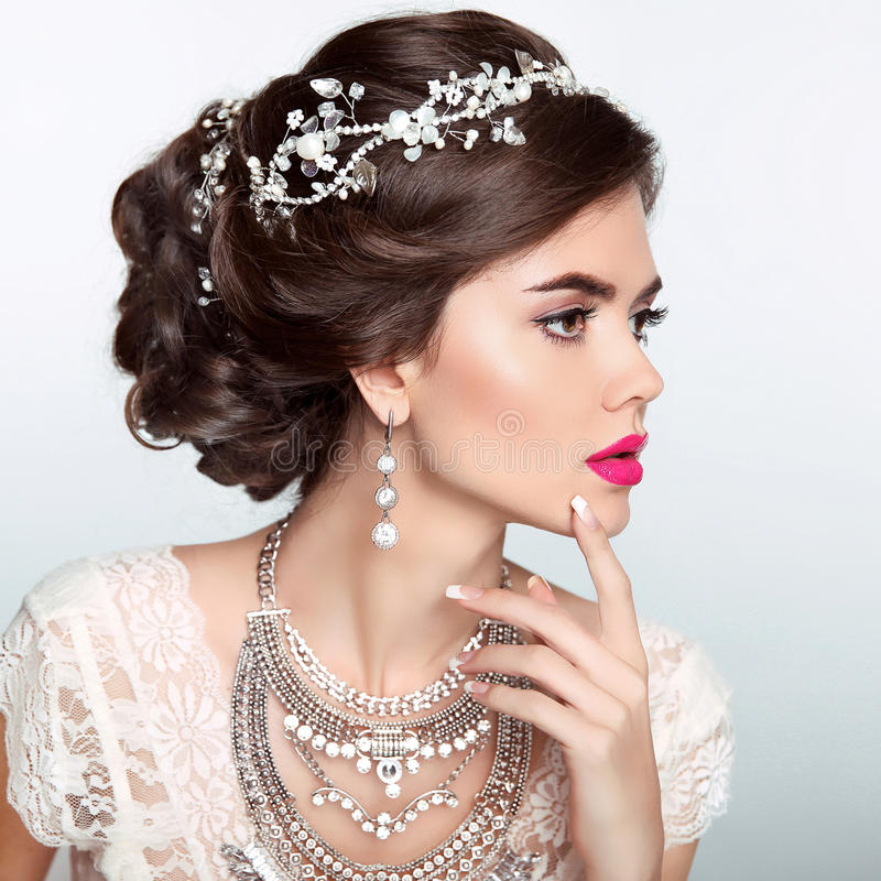 Beauty Fashion Model Girl with wedding elegant hairstyle. Beautiful bride woman with precious jewels, manicured nails. Makeup. royalty free stock photos