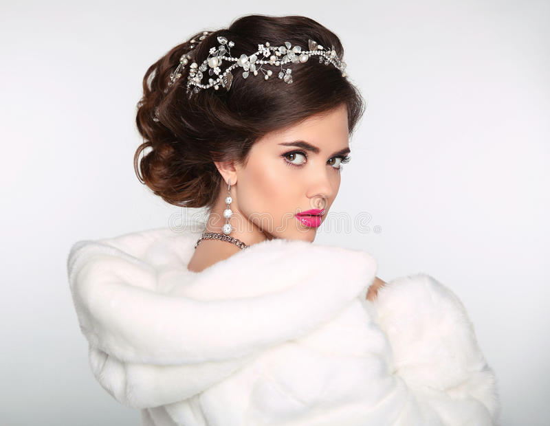 Beauty Fashion Model Girl in white Mink Fur Coat. Wedding hairstyle. Beautiful Luxury Winter Woman isolated on white background. royalty free stock photos