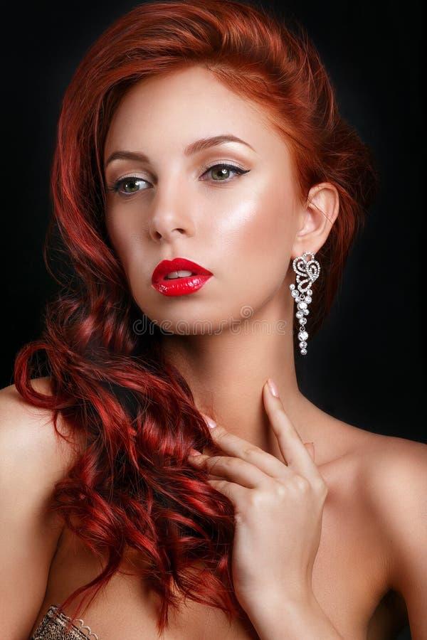 Beauty fashion model retro girl over black background. Vintage style Woman Portrait. Luxury Lady. Vintage Style Lady with Beautiful Luxury Hairstyle, makeup royalty free stock photo