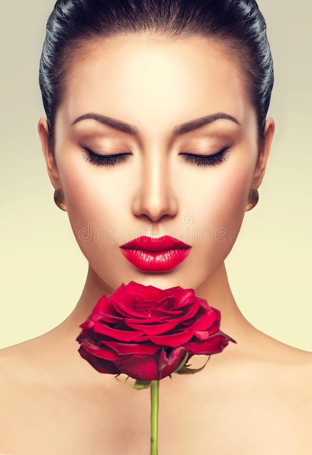 Beauty fashion model woman with red rose flower royalty free stock photos