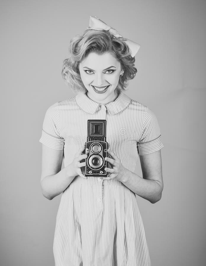 Beauty, fashion photography, vintage style. Family portrait, old fashion, journalism, pinup. Retro woman with vintage camera. Retro woman hold photo camera royalty free stock photo