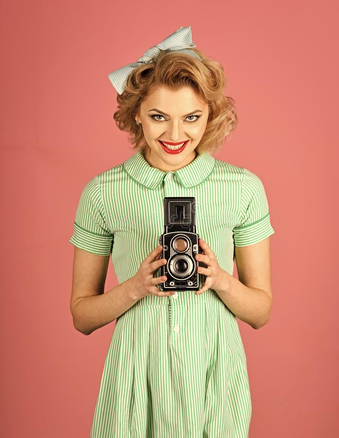Beauty, fashion photography, vintage style. Family portrait, old fashion, journalism, pinup. Retro woman with vintage camera. Retro woman hold photo camera royalty free stock images
