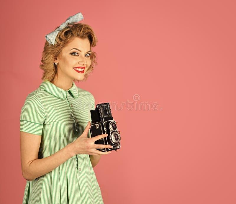 Beauty, fashion photography, vintage style. Retro woman hold photo camera. Family portrait, old fashion, journalism, pinup. Retro woman with vintage camera royalty free stock photo